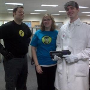 Photo of Dr. Horrible cosplayers in costume as the Dr. and Groupies.