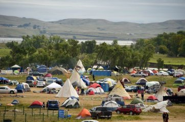 The Missouri River is seen beyond an encampment September 4, 2016 near Cannon Ball, North Dakota where hundreds of people have gathered to join the Standing Rock Sioux Tribe's protest of the Dakota Access Pipeline (DAPL) that is slated to transport approximately 470,000 barrels of oil per day from the Bakken Oil Field in North Dakota to refineries in Illinois. Protestors were attacked by dogs and sprayed with an eye and respiratory irritant yesterday when they arrived at the site to protest after learning of the bulldozing work. / AFP / Robyn BECK (Photo credit should read ROBYN BECK/AFP/Getty Images)